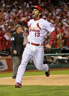 Matt Carpenter celebrates scoring the first run on a Carlos Beltran single in the third inning of Game 6 of the National League Championship...