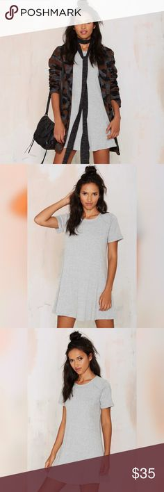 """Heather Grey T-Shirt Dress New. Brand is Very J, sold at Nasty Gal. The Lani Dress is made in a heather gray ribbed knit and features panel design, fit and flare silhouette, and scoop neck. Stretch fabric. Credit to Nasty Gal for model photos.  100% cotton. 32"""" length • 18"""" pit to pit • 18.5"""" waist flat. Nasty Gal Dresses"""