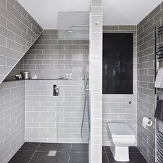 Grey bathroom with floor-to-ceiling tiles