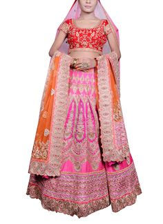 Pink is the new red in Indian bridal wear and this Saroj Jalan lehenga adopts the colour to produce a winner. The bright pink raw silk lehenga is fully embroidered with golden thread work and rows of exquisite embroidered borders in orange, pink and scalloped broad one at the hem. It is teamed with a matching raw silk blouse with all over embroidery and dark pink border. The set also includes an orange buti design dupatta with a scalloped border. A gorgeous pink net stole with all over buti…