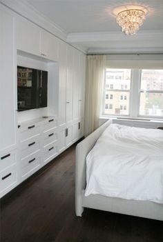 Suzie: Curated - Great storage space in master bedroom. Light gray linen bed, crisp white ...