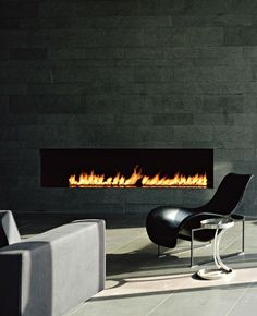 warm your room up with modern fireplace design: delectable schein loft by archi tectonics image modern fireplace wall is located near the light brown sofa and cool black chair Home Fireplace, Black Fireplace, Fireplace Design, Minimalist Fireplace, Linear Fireplace, Inglenook Fireplace, Fireplace Ideas, Interior Architecture, Interior And Exterior