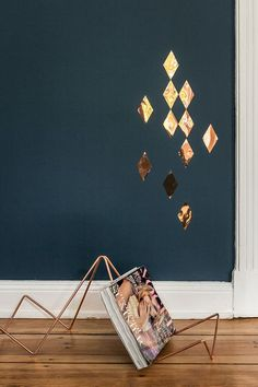 This copper magazine rack is gorgeous. I love the contrast of the deep blue wall too.