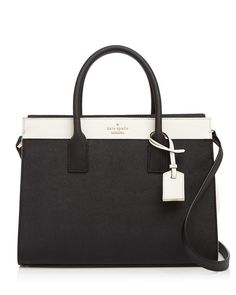 With a convertible strap, kate spade new york's sturdy saffiano leather satchel is easy to carry on the go. A color blocked design makes for a crisp and polished look. | Leather/polyurethane; lining: