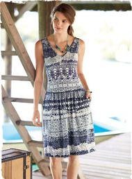 African mud cloth motifs pattern our appealing dress in shades of brilliant blues. Viscose (92%) and elastane (8%) jersey. V-neck front and back; drop waist; gathered skirt with pockets.