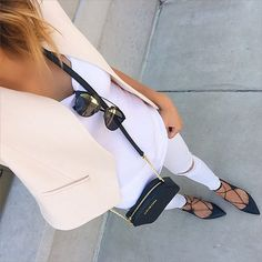 White basics with a blush colored vest and black lace-ups.