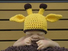 WHAT is this freaky baby thing?! The hat is cute.. but really... just use a ball or something to model it. eeeeeew!