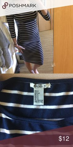 Bodycon navy and white striped dress Calf length 3/4 sleeve body con dress in great condition! Wore it once! Forever 21 Dresses Midi