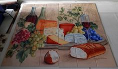Wine and Cheese I - MT - Tile Mural Our decorative tiles with wine are perfect to use for your kitchen splash back tile project. A wine tile mural adds elegance and interest to your kitchen wall tile area and makes a wonderful kitchen splash-back idea. Pictures of wine on tiles and images of wines bottles on tiles and wine glasses on tiles is timeless and these decorative tiles of wine blend with any decor.