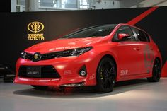 Not to be outdone by Volkswagen, Toyota is slated to sell a nerdy car of its own: a Toyota Auris customized in the image of Gundam character Char Aznable. Toyota Auris, All Cars, Custom Cars, Gundam, Kayaking, Super Cars, Volkswagen, Bicycle, Comic Books