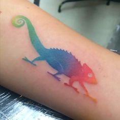 A simple colorful tattoo idea of a chameleon inked on the forearm. Color: Colorful. Tags: First, Easy