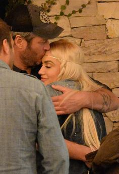 Gwen Stefani and Blake Shelton shared a sweet kiss and laughs while waiting for valet after a date night in Studio City, Calif., on Tuesday, Dec. 8 — photos