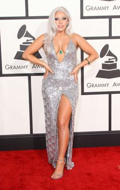 Lady Gaga wears a sequin gown with a high slit and plunging v-neck with silver sandals.