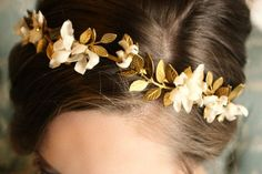 Elaena C.-She wore gold flowers in her hair despite protesting that she was not deserving of such things