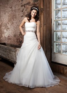 Sincerity wedding dress style 3711 Strapless sweetheart organza asymmetrical draped A-line with buttons over the back zipper. Beaded belt included with organza tie, chapel length train. Available dress only as 3717.     @Terri Franz