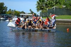 After successfully navigating the course, rowers in the Accuform Signs cardboard boat decide to get wet anyway. 1st Annual Cardboard Boat Race in Hernando County Florida on September 21, 2013