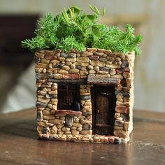 This little fairy house doubles as a fully functional flower pot. Note: The door on this house does not open.