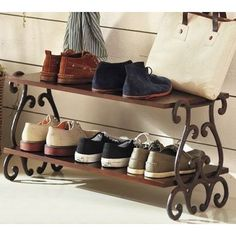 Cute shoe holder by the door! (no idea where this pic came from, but I would love to have this by the back door to tidy the shoe drop off area...)