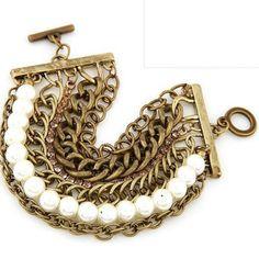 Brazalete metalico con perlas dorado multiple