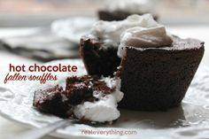 A fluffy rich chocolate cupcake that is ever so slightly gooey in the center, topped with a dollop of whipped cream, reminiscent of hot chocolate!