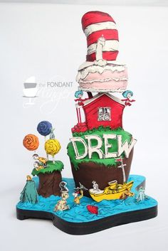 Carved and stacked Dr. Seuss cake with decorations from Green Eggs and Ham, Lorax, Cat in the Hat, One Fish, Two Fish, etc. approximately 26 inches in height. Characters were cut with an X-acto knife and finished with colored fondant and hand-painted black details. House, trees and small island were rice crispy treats covered in modeling chocolate and gum paste details. Seuss hat lifted off to be the smash cake for the birthday boy.  -- www.facebook.com/fondantflinger