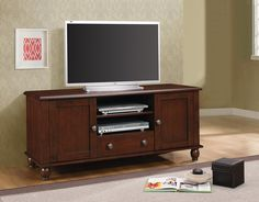 Coaster Home Furnishings 704411 TV Console, Dark Cherry. This genuine Coaster Furniture product Comes finished in Merlot. This piece measures 51 L x 19. 75 W x 23. 75 H. Features two door storage, two compartments, and one drawer in the center Finish: Merlot maximum TV size: 50 inches maximum TV weight: 300 pounds.