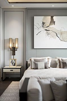 offset shadow gap coffer; contemporary full-height paneling; cream, grey luxury bedroom; feature artwork; wall covering paneling; elegant bedroom; bronze rectangular double wall sconce; Olivia Palermo; square downlights