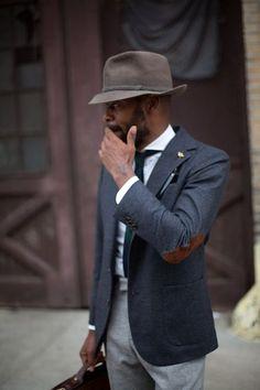 A dark grey wool sportcoat and grey wool suit pants will showcase your sartorial self.  Shop this look for $143:  http://lookastic.com/men/looks/hat-dress-shirt-tie-blazer-dress-pants/6673  — Dark Brown Wool Hat  — White Dress Shirt  — Dark Green Tie  — Charcoal Wool Blazer  — Grey Wool Dress Pants