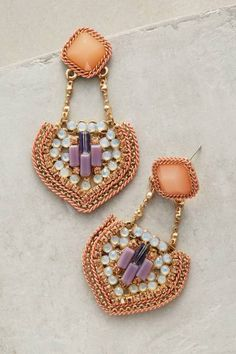 Anthropologie statement earrings: http://www.stylemepretty.com/living/2015/10/10/spotted-on-saturday-50-under-50/