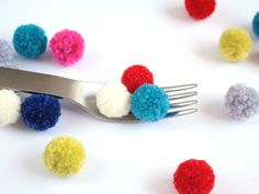 Top your gifts with these DIY pom poms this holiday season.