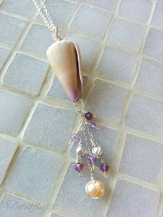 A new creation! The Lei Pūpū (Shell Necklace), made with sterling silver wire & chain, as well as a handpicked shell from the shores of Maui, Hawai'i! Only 1 available! Check it out at http://tidalfluxx.storenvy.com
