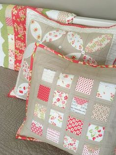 """Carried Away Quilting's free pillow tutorial, """"Love Notes"""" is perfect for mini charm packs, prairie points, and bits of trim. Sample features Fig Tree fabrics with Moda Cross Weave in sand for sashing and borders."""