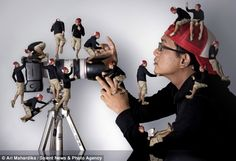 Tiny friends: Ari Mahardika appears to have cloned himself dozens of times over in this bizarre series of photo montages