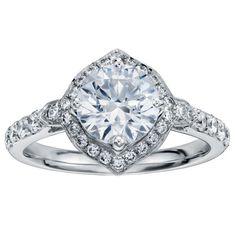Pavé set diamond halo in platinum by Monique Lhuillier for Blue Nile.