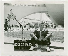 Man and mechanical hand in suitcase. New York World's Fair (1939-1940). NYPL Digital Gallery.