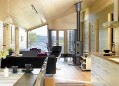 LUFTIG: De store vinduene gir hytta et lyst og luftig uttrykk