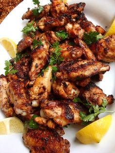 Grilled Chicken Wings Marinated in Preserved Lemon, Roasted Garlic, and Paprika