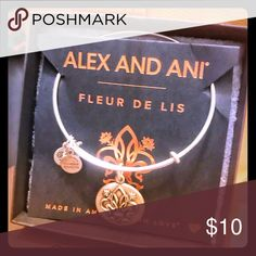 Alex and Ani bracelet Fleur de Lis New silver New in box never worn Fleur de Lis silver bracelet. Words on back: renewal, regality, faith Alex and Ani Jewelry Bracelets