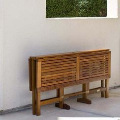 Foldable outdoor wooden dining table.
