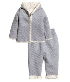 $24.99-BABY EXCLUSIVE/CONSCIOUS. Set with jacket and pants in quilted jersey made from an organic cotton blend. Jacket with long sleeves, lined hood with pompom at top,  snap fasteners at front, and no lining. Pants with wide, foldover ribbing at waist. Patterned trim at hems, visible when pant legs are rolled. - Visit hm.com to see more.