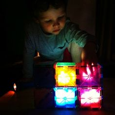 LED candle lights inside Magna-Tiles - turn out the lights and let the kids go to town building!