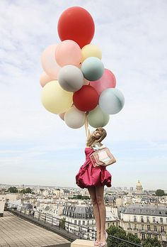 On top of the world! Balloons and girls always mix. Nice background.     #balloons #fashion