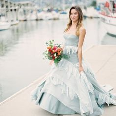 A colorful nautical shoot on the coast with an epic blue wedding dress that can't be missed!