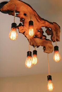 20 Beautiful DIY Wood Lamps And Chandeliers That Will Light Up Your Home Raw edge wood slab with vintage Edison pendant lights. The post 20 Beautiful DIY Wood Lamps And Chandeliers That Will Light Up Your Home appeared first on Wood Diy. Edison Bulb Chandelier, Edison Lampe, Rustic Chandelier, Rustic Lighting, Lighting Design, Edison Bulbs, Chandeliers, Chandelier Ideas, Lighting Ideas