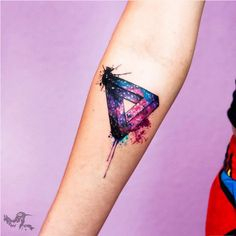 This dripping, cosmic illusion. | 31 Celestial Tattoos That Will Look Magical On Anyone