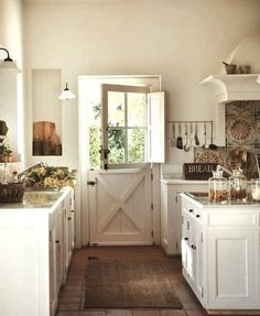 White With Time Worn Woods And Collected Pieces With Loving Patina. I Am  Really Loving That Farm Door In The Kitchen!