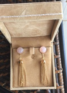 A personal favorite from my Etsy shop https://www.etsy.com/listing/387218038/natural-rose-quartz-tassel-designer-drop