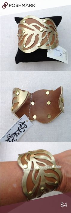 """Cuff bracelet Gold tone and faux leather.  2 small tarnish areas see last pic.  They are on the side and I hardly noticed until I looked real close.  Easily slips on and off for me and my wrist is no bigger than 6.500"""" Never worn. Jewelry Bracelets"""