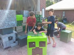 How do you get y boys to unplug from the Xbox, PlayStation,Wii or computer, stop playing Minecraft and go outside?! Try decorating cardboard boxes Minecraft style for building. These boys range in she from 4 to 9 and they're all having a good time.