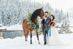 Stunning Winter Weddings flowers utah calie rose wine burgundy plum bouquet flowers flowing blue silk ribbon horse wreath horse flowers